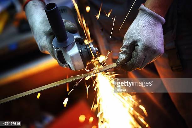 Grinding metal rod.