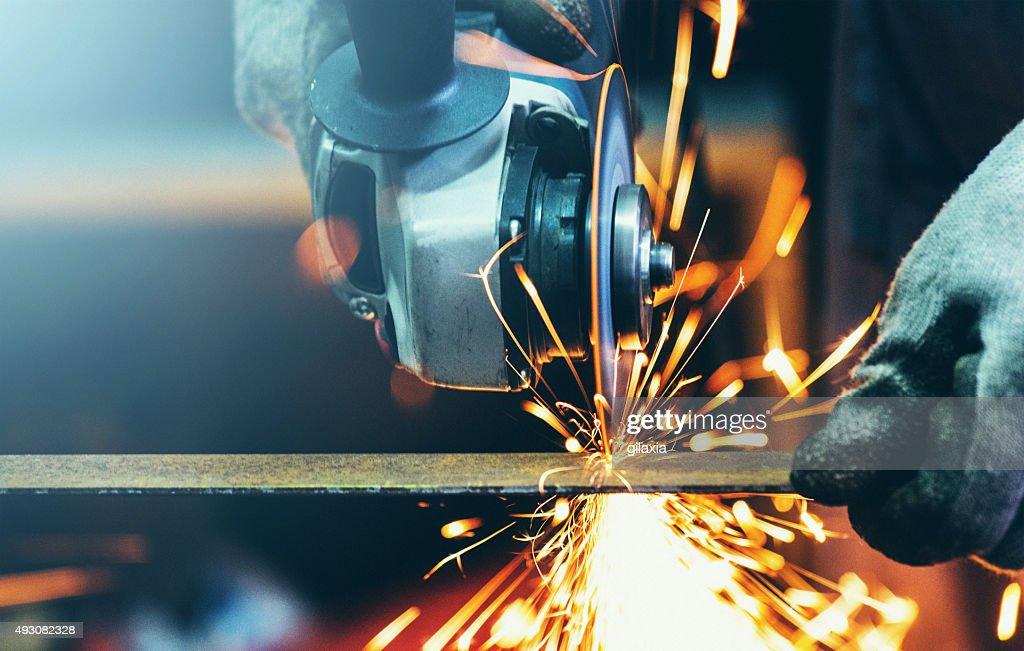 Grinding steel tube. : Stock Photo