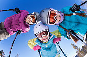 Grinning family skiing together