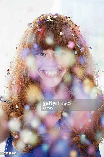 A grinning woman with falling confetti