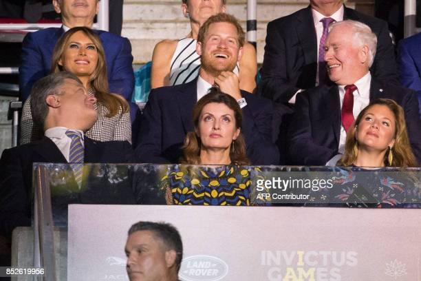 Grintain's Prince Harry shares a laugh with Ukrainian President Petro Poroshenko US first lady Melania Trump and Governor General David Johnston...