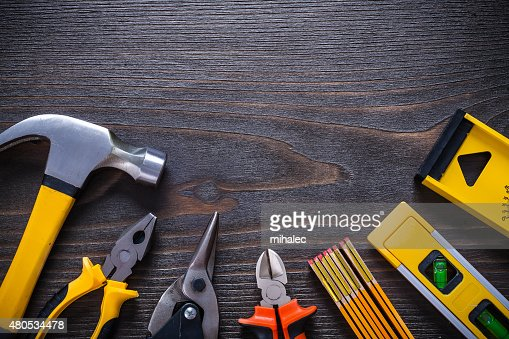 Gripping tongs nippers tin snips claw hammer try square construc : Stock Photo