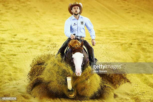 Grischa Ludwig of Germany rides on his horse Shine my Gun during the Reining team competition on Day 3 of the FEI European Equestrian Championship...
