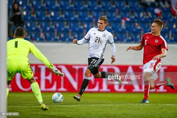 Grischa Proemel of Germany challenges Goalkeeper Daniel Bachmann and Philipp Lienhart of Austria for the ball during the 2017 UEFA European U21...