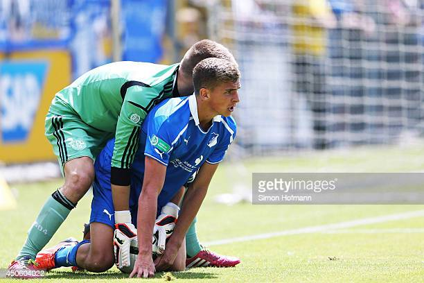 Grischa Proemel of Hoffenheim is challenged by goalkeeper Timon Wellenreuther of Schalke during the A Juniors Bundesliga Semi Final between 1899...