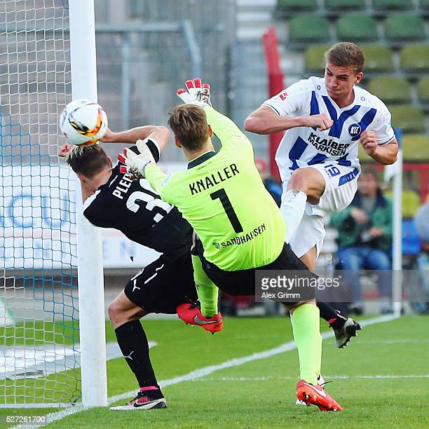 Grischa Proemel of Karlsruhe scores his team's second goal against goalkeeper Marco Knaller and Thomas Pledl of Sandhausen during the Second...