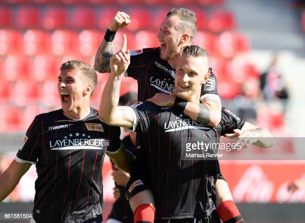 Grischa Proemel Sebastian Polter and Marcel Hartel of 1 FC Union Berlin celebrate after scoring the 01 during the Second Bundesliga match between...