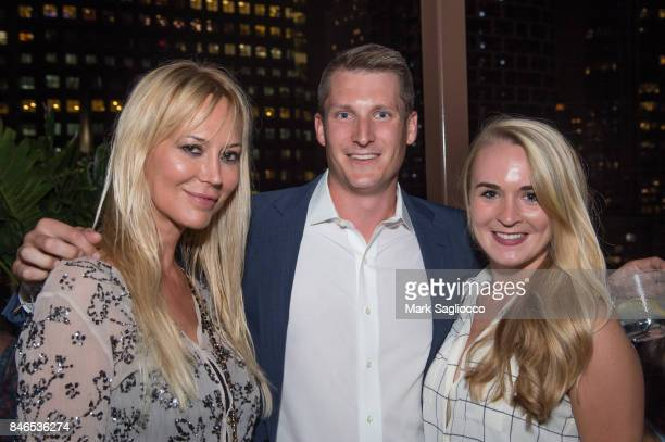 Griselda Lechini Jeffrey Costikyan and Laura Newell attend Hamptons Magazine's Celebration with Cover Star Maria Sharapova at PHD Terrace at Dream...