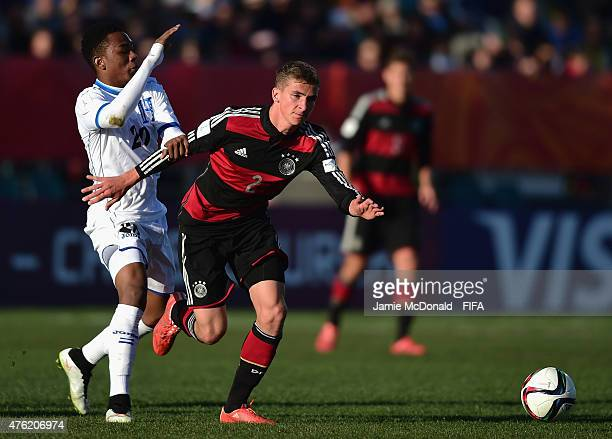 Grisha Proemel of Germany is tackled by Deybi Flores of Honduras during the FIFA U20 World Cup New Zealand 2015 Group F match between Honduras and...