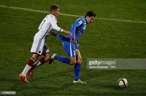 Grisha Promel of Gemany battles with Otabek Shukurov of Uzberkistan during the FIFA U20 World Cup New Zealand 2015 Group F match between Germany and...