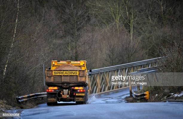 A gritting lorry lays down salt on a country road in Caerphilly South Wales in preparation for more snow and bad weather