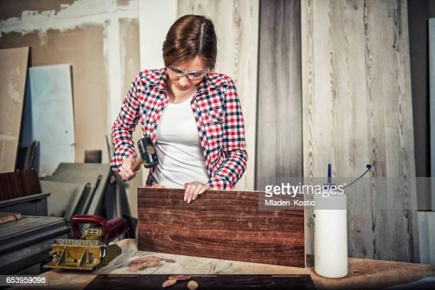 Gritty women working in a workshop