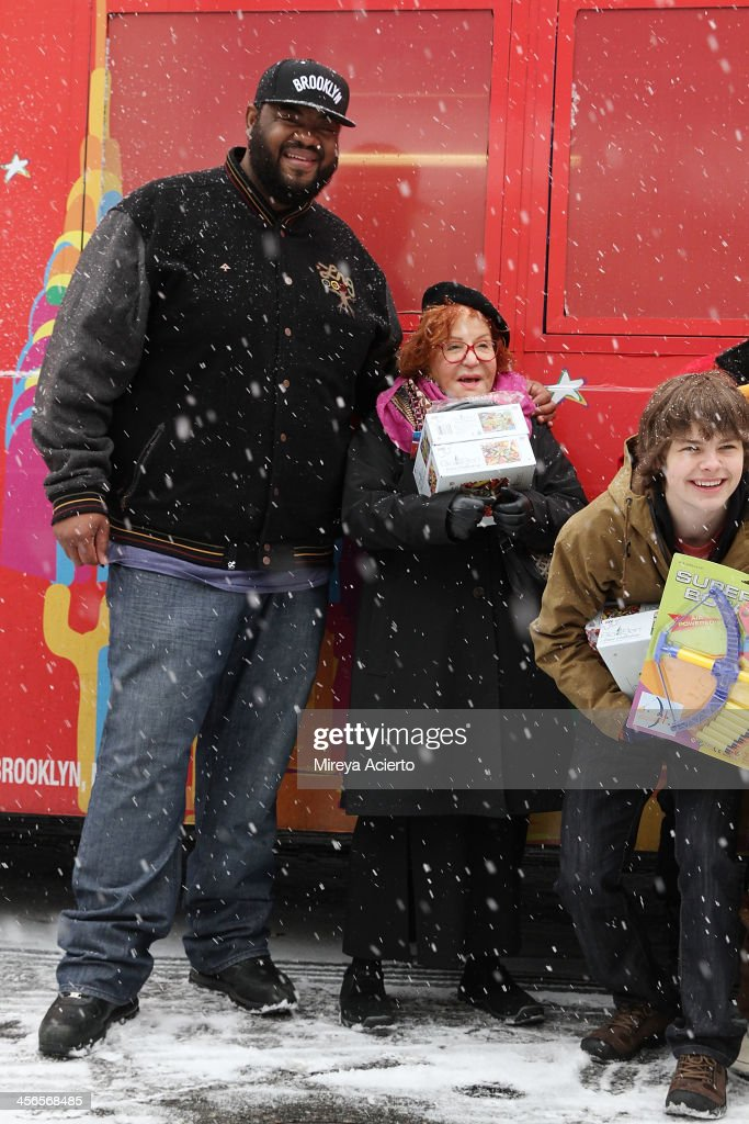 Grizz Chapman, Sally Jessy Rafael and Brenden Meyer attend CitySightseeing New York 2013 holiday toy drive at PAL's Harlem Center on December 14, 2013 in New York City.