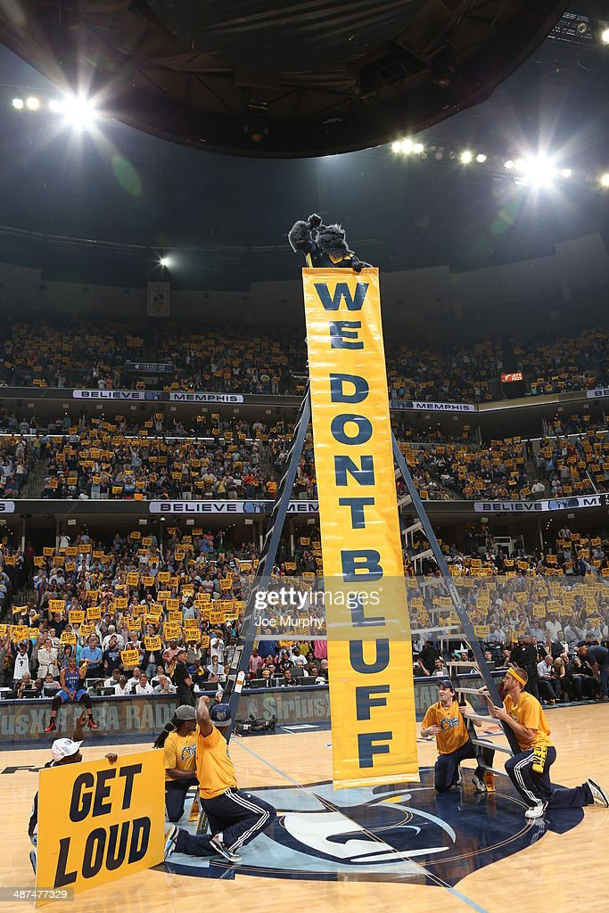 Grizz, the masoct of the Memphis Grizzlies hold up a sign of the theme song 'We Don't Bluff' during the game against the Oklahoma City Thunder in Game Four of the Western Conference Quarterfinals during the 2014 NBA Playoffs on April 26, 2014 at FedExForum in Memphis, Tennessee.