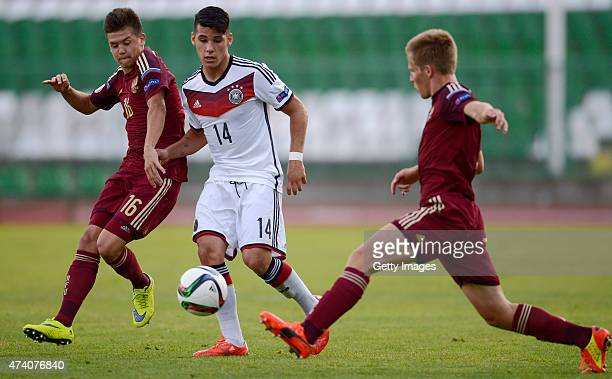Görkem Saglam of Germany U17 challenges Dmitri Pletnev of Russia U17 during the UEFA European Under17 Championship Semi Final match between Germany...