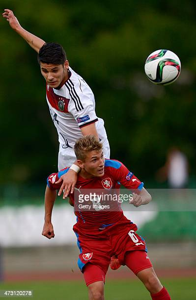 Görkem Saglam of Germany U17 jumps for the ball with Michal Sadílek of Czech Republic U17 during the UEFA European Under17 Championship match between...