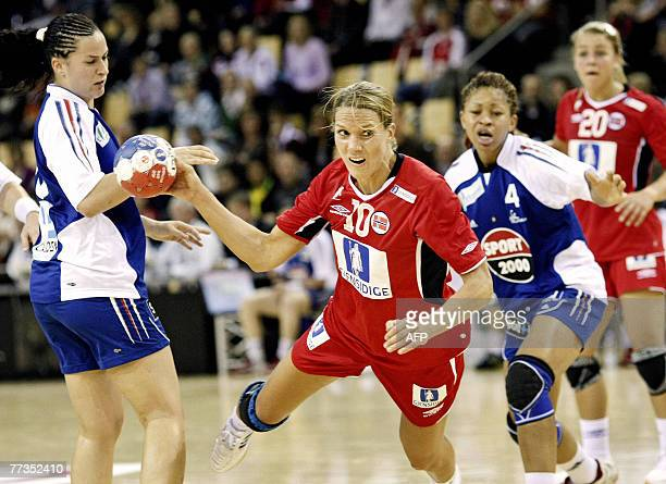 Gro Hammerseng of Norway jumps to shoot followed by Camille Ayglon and Nina Kanto of France during their World Cup tournament handball match 16...