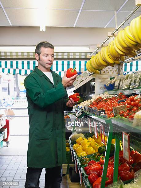 Grocer checking quality of produce