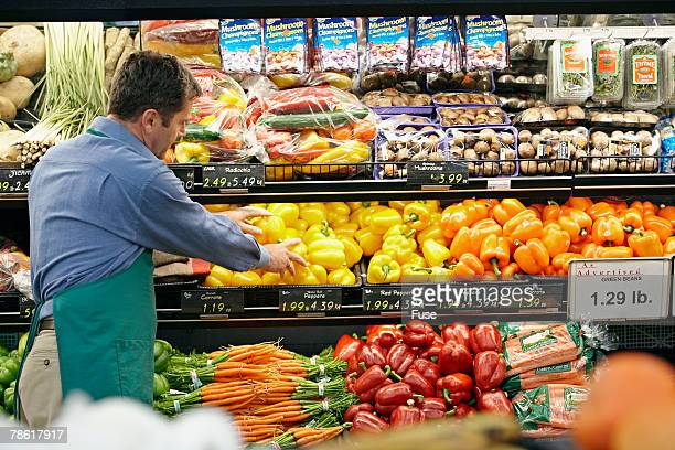 Grocer Stocking Bell Peppers