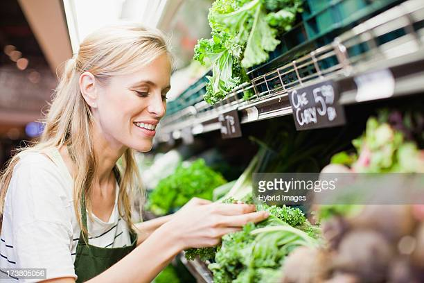 Grocer working in produce section
