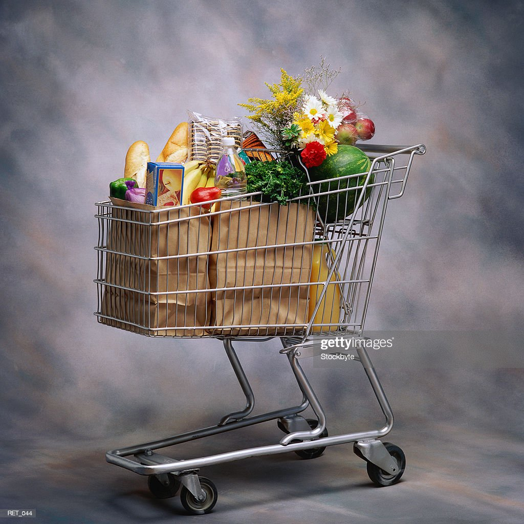 Groceries and flowers in shopping cart