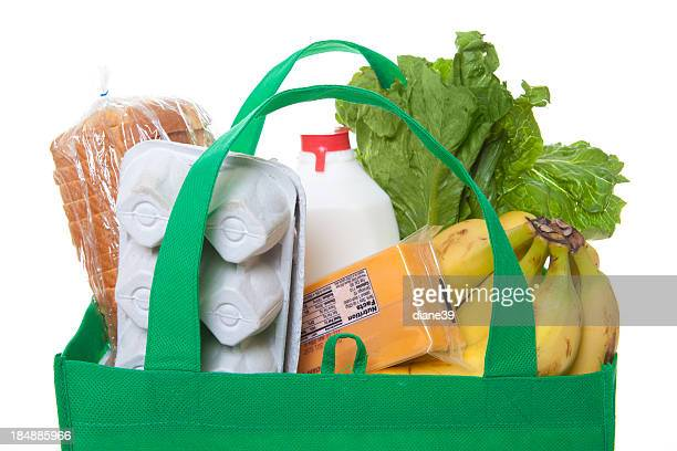 groceries in a green reusable shopping bag