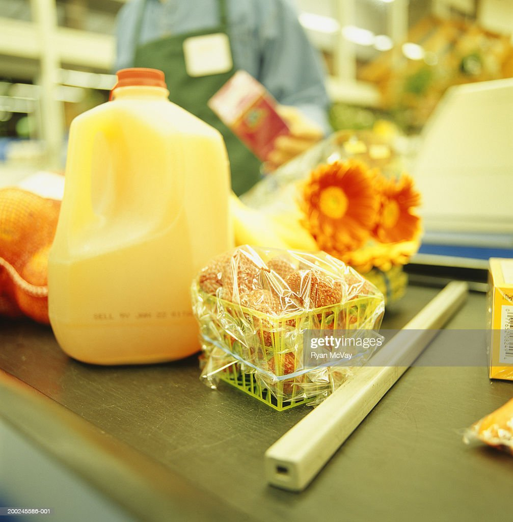 Groceries on conveyor belt at checkout counter (Close-up)