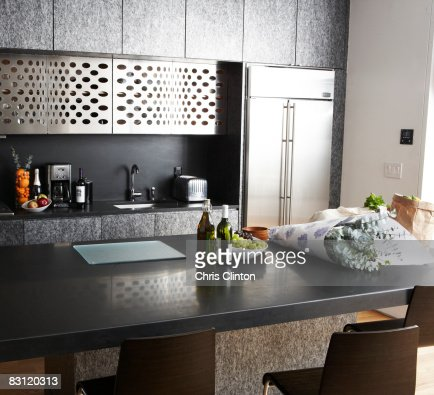 Groceries on counter in modern kitchen : Stock Photo