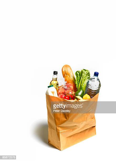 Groceries, shopping in brown paper bag