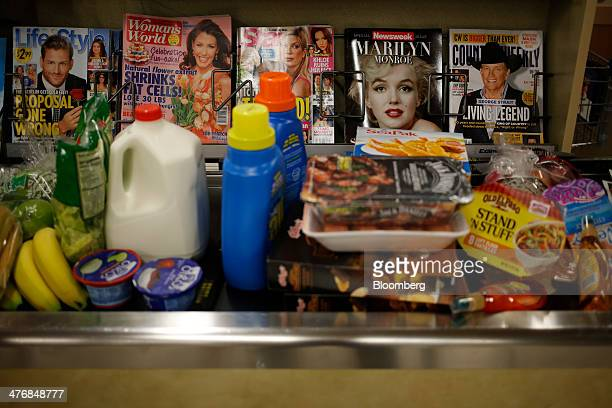 Groceries sits on a conveyor belt in the checkout line at a Publix Super Markets Inc grocery store in Knoxville Tennessee US on Wednesday March 5...