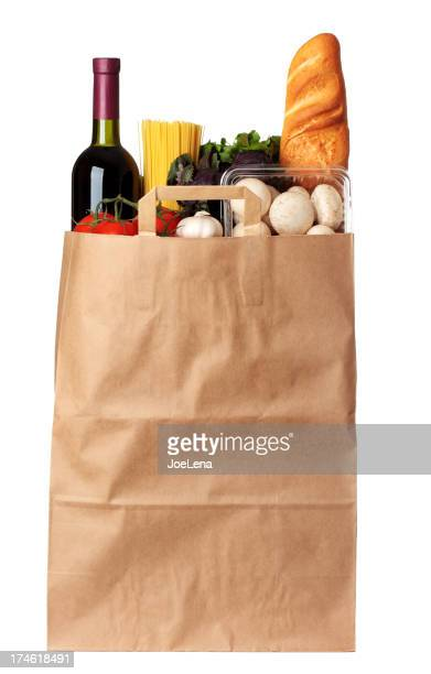 Groceries stuffed in brown paper bag