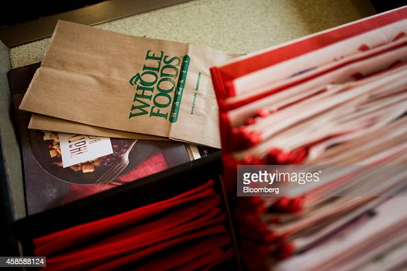 A grocery bag sits on the counter of the checkout line at a Whole Foods Market Inc store in Dublin Ohio US on Friday Nov 7 2014 Whole Foods Market...