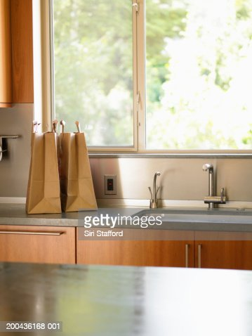 Grocery bags on kitchen counter : Stock Photo