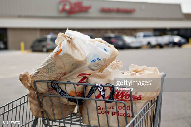 Grocery bags sit in a cart outside of a Dillons Food Stores supermarket owned by Kroger Co in Hays Kansas US on Thursday June 29 2017 Kroger remains...