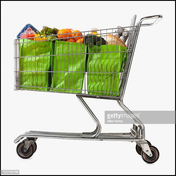 Grocery cart full of bags of groceries