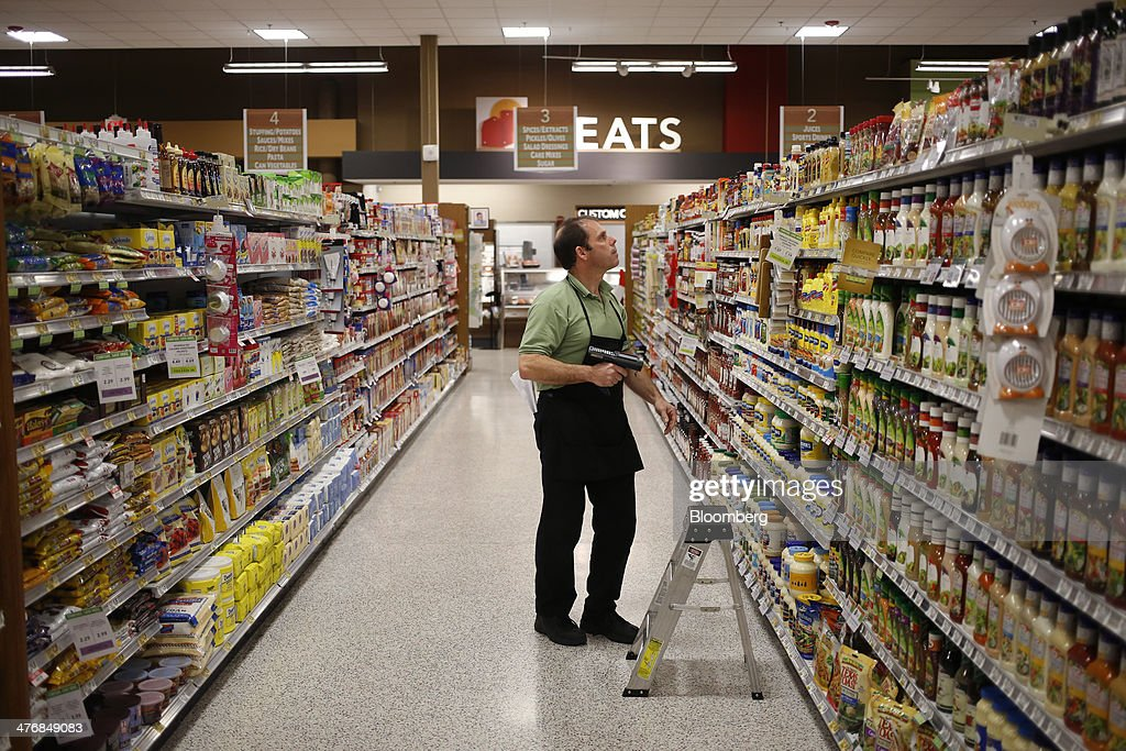 Grocery clerk James Delarosa takes inventory of the salad dressing and condiments aisle at a Publix Super Markets Inc. grocery store in Knoxville, Tennessee, U.S., on Wednesday, March 5, 2014. Publix's sales for the fourth quarter of 2013, were $7.4billion, a 5.3 percent increase from last year's $7.0 billion. Photographer: Luke Sharrett/Bloomberg via Getty Images