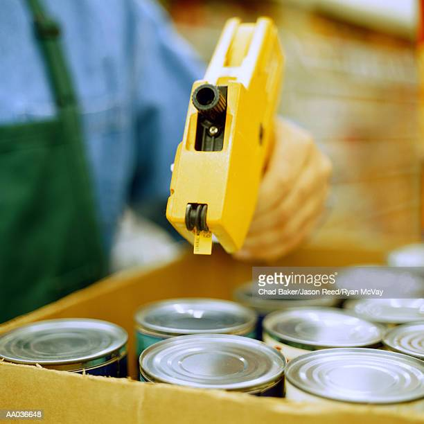 Grocery Clerk Pricing Canned Goods