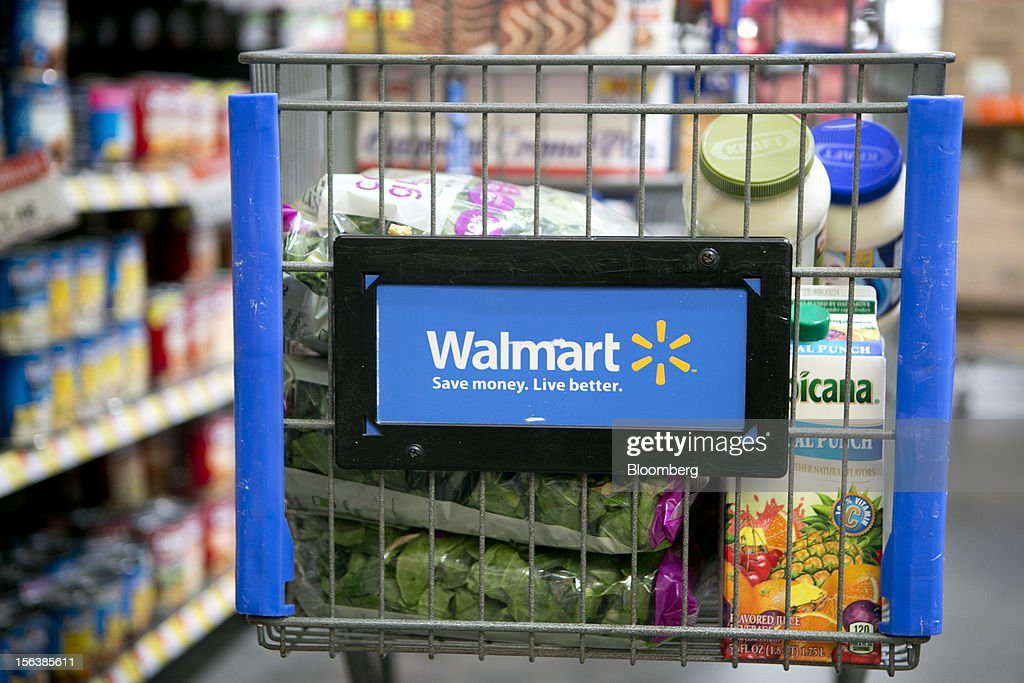 Grocery items sit inside a cart at a Wal-Mart store in Alexandria, Virginia, U.S., on Wednesday, Nov. 14, 2012. Wal-Mart Stores Inc. is scheduled to release earnings data on Nov. 15. Photographer: Andrew Harrer/Bloomberg via Getty Images
