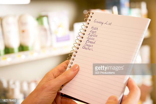 Grocery Shopper Checking Her List at the Store