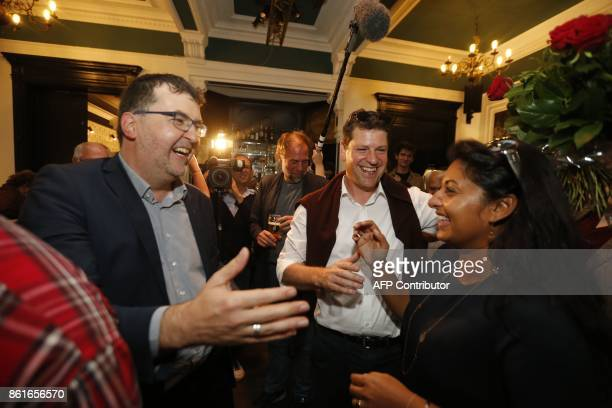 Groen's Wouter Van Besien SPA's Tom Meeuws and Police commissary Jinnih Beels celebrate at a press conference of the local branches of Flemish...