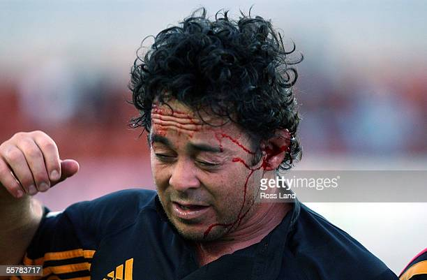 A groggy Greg Smith is helped from the field after being stomped by Auckland No4 Troy Flavell during the Super12 match at at Waikato Stadium Hamilton...