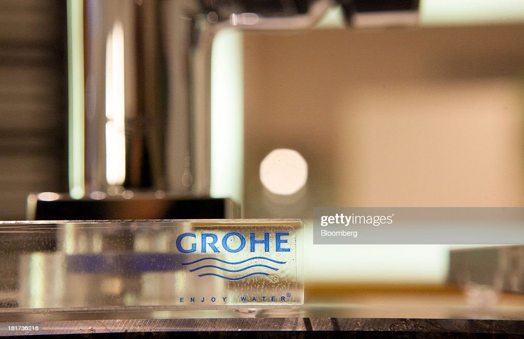 A Grohe logo for the Grohe Group is seen on a perspex display block at a bathroom-fixtures store in Berlin, Germany, on Tuesday, Sept. 24, 2013. Lixil Corp., a Japanese toilet maker, is in advanced talks to buy German bathroom-fixtures company Grohe Group for more than 3 billion euros ($4 billion), according to people with knowledge of the matter. Photographer: Krisztian Bocsi/Bloomberg via Getty Images