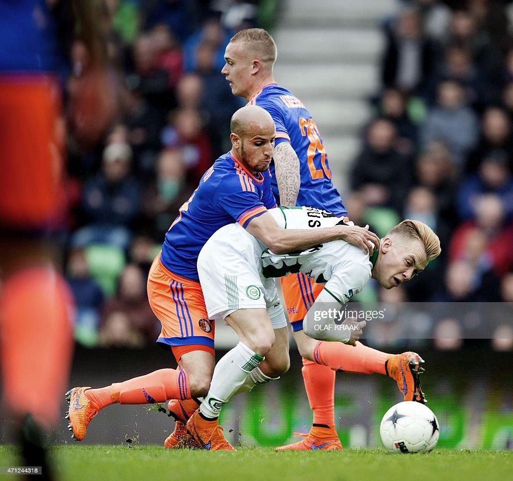 Groningen's Czech midfiedler Albert Rusnak vies for the ball with Feyenoord Rotterdam's Maroccan midfielder Karim El Ahmadi during the Eredivisie...