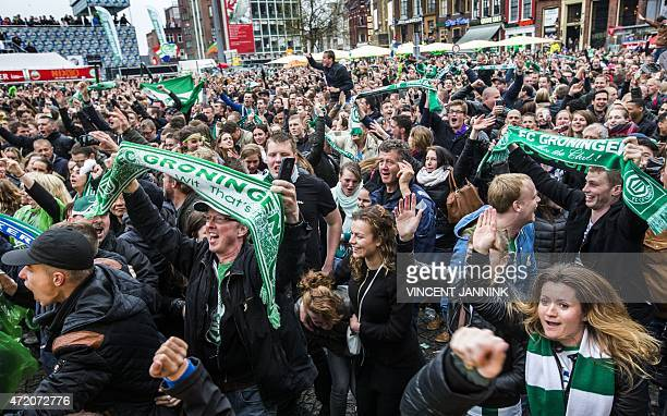 Groningen's supporters celebrate at the end of the Dutch KNVB Cup football final match between PEC Zwolle and FC Groningen on May 3 2015 at the...