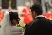 A groom and a bride look at each other during their wedding ceremony celebrated as part of a mass by Pope Francis at St Peter's basilica on September...