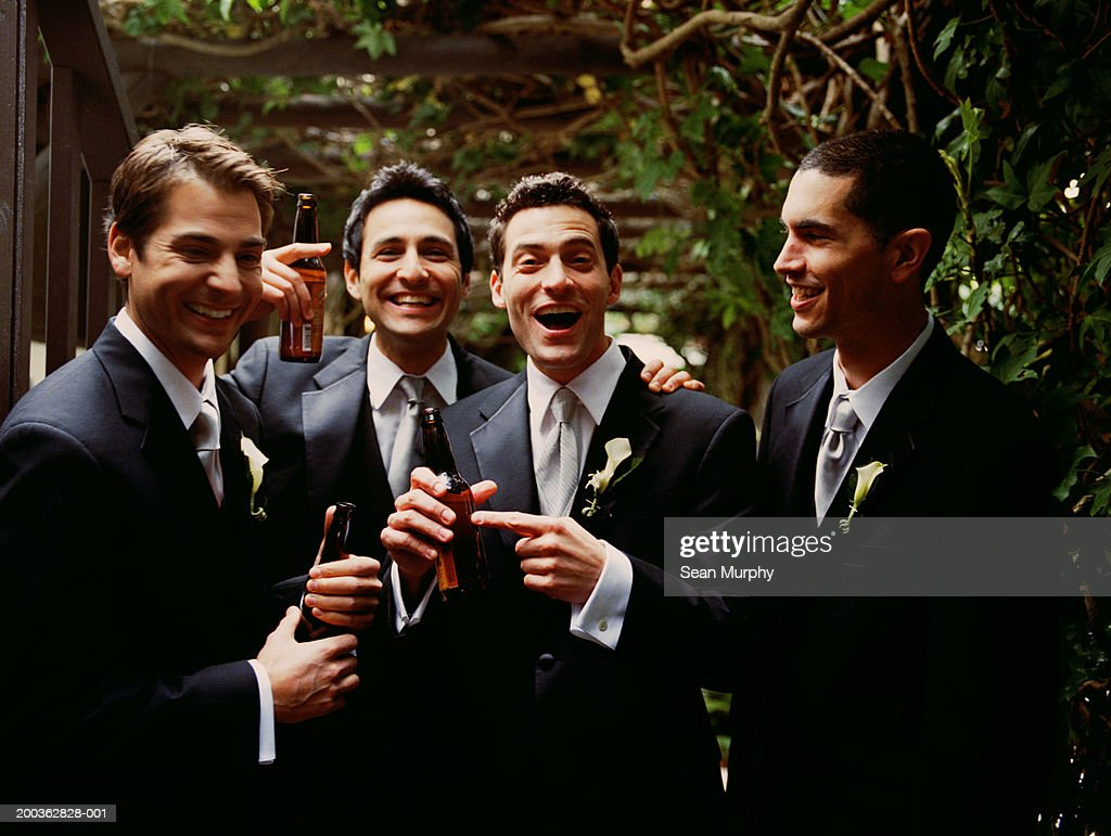 Groom and groomsmen having beer : Stock Photo