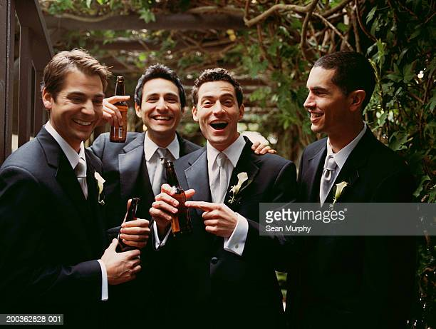 Groom and groomsmen having beer