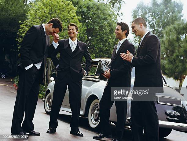 Groom and groomsmen laughing