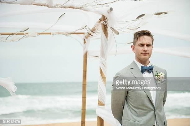 Groom awaiting bride on beach