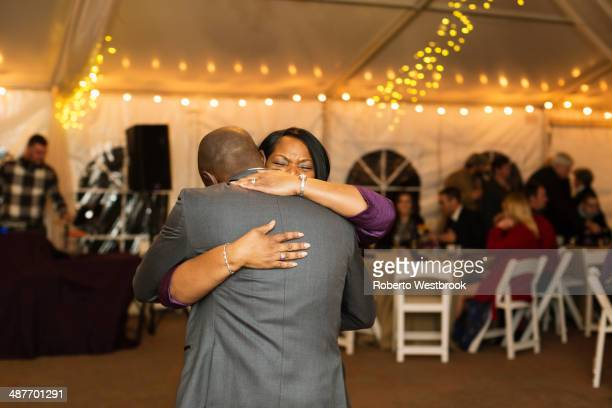 Groom dancing with mother at reception